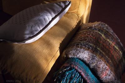 """23-Apr-2012  """"Las mantitas"""" - Normalmente están sobre un revistero junto a uno de los sofás, y mis hijas a veces las utilizan cuando se tumban. Puli también se aprovechaba de ellas algunas veces. La foto está hecha hace unas días, por la mañana temprano, con el sol todavía bajo entrando por la ventana del comedor. (Siempre mejor en grande)  """"The little blankets"""" - They are normally over a magazine rack next to one of the sofas and my daughters some times use them when they lie down. Puli also took advantage of them some times. The photo was taken a few days ago, early in the morning, with the sun still quite low and entering through the dining room window. (Always best in lage size)"""