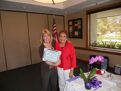 "Jackie Piro with President Cherie, displaing her ""Ratchet It Up a Notch"" Award."