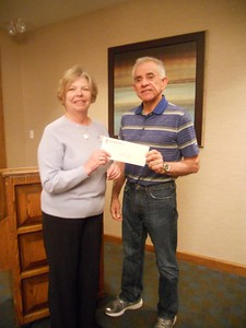 Kaye Van Nevel (left) accepts $6500 check from Michael Bravo Lopez, president of the Guadalupe Charitable Trust. The grant money will be used to help two houses for human trafficking victims as well as help our club raise awareness and for training our members in grant writing.