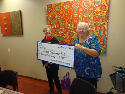 Jean Cole presents $8000 check from United Methodist Church's Cable Grant Foundation to Kaye Van Nevel. The grant will be used to further the club's ongoing Stop Trafficking efforts.