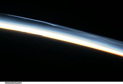Caption by Space Station Academy student: The black, red, and blue are colors of space, the sun, and the earth. The sun is slowly dawning on the earth and it's time to prepare for the day. The blend of colors look amazing. Seeing  that the sun is dawning away shows that a new day is approaching.