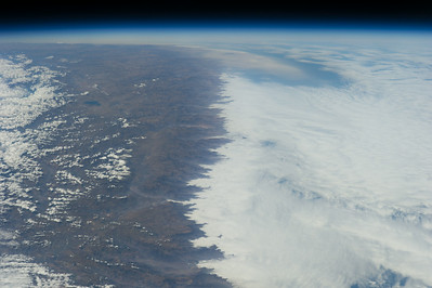 Caption by Space Station Academy student: The picture shows mountains near Manta, Ecuador. Some part of the mountains have ice, while the other part does not. It is really noticeable. I really like how you can see the separation between the ice and the mountain. This indirectly tells me that the left part of the mountains is at a lower altitude than the right part of the mountains.
