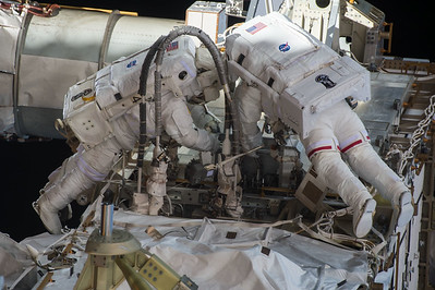 Teamwork! @astro_kjell and I working outside @Space_Station with @Astro_Kimiya inside getting us safely out the door