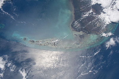 Coral cay archipelago with a 7 mile long bridge between 2 of its islands. ISS over the Gulf of Mexico. (ANSWER: the Florida Keys in the US)