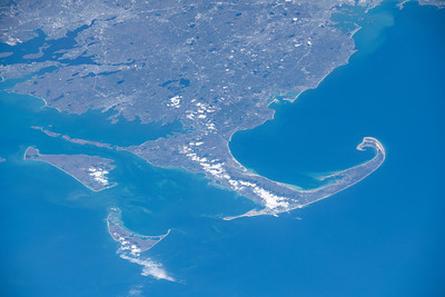 A popular cape for tourists with many beaches, consisting mostly of glacial landforms. ISS over the Atlantic ocean. (ANSWER: Cape Cod, Massachusetts, United States)