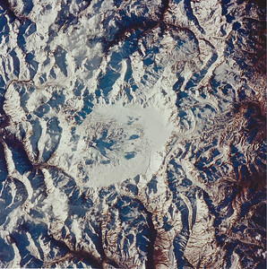 Astronaut Tom Jones: Maipo Volcano, in the Andes on the Chile/Argentina border, taken by the STS-68 Endeavour crew on Oct. 5, 1994. It's about 17,300 ft. above sea level. Lago Diamante (Diamond Lake) is just to the east, here covered by ice and snow. See the interesting Wiki entry at: http://en.wikipedia.org/wiki/Maipo_(volcano)