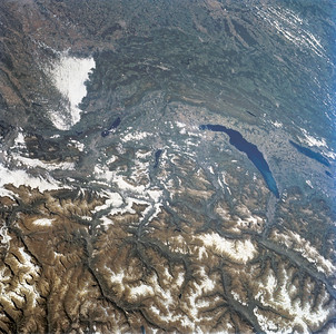 Astronaut Tom Jones: gIt's rare to get a cloud-free pass above the Alps; here is a treat from Space Radar Lab 2. Lake Geneva dominates the center right; Geneva city is at the left, narrow end of the lake. Lake Geneva is fed by the Rhone River, with its spectacular right-angle turn to the east upstream from the lake. At far right center is Lake Neuchatel; Berne is just out of view, to the right. Lac du Bourget is the small lake left of center. Lyons is under the clouds at upper left. Here in early autumn, the snows have not moved into the Alps as yet, but a few high glaciers are still beautifully evident to my crew.  From NASA: Parts of the Swiss Cantons of Vaud and Valois, the French province of Chablis and parts of northwestern Italy are seen in this widely stretching image photographed from the Space Shuttle Endeavour. Pennine Alps, said to have been created 50 million years ago, have been reshaped by glaciers during Pleistocene. The glaciers created the wide valley of the Rhone River by scourting a pre-existing seam. The fertile Swiss Plateau runs northwest from the shore of Lake Geneva and is visible in lower left. The Franco-Swiss border is located in the center of the lake and follows a mountain divide east of Rhone Valley. Italy lies south of the Rhone.