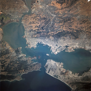 Astronaut Tom Jones: All of us enjoyed our repeated views of San Francisco Bay and the San Andreas Fault, running left to right in the bottom of the image below. Steve Smith and Jeff Wisoff were both Stanford grads, and Mike Baker hails from this part of the country. Urban growth patterns and the many tectonic faults and features were the focus of our radar and camera studies here.  NASA: Photographed through the Space Shuttle Endeavour's flight deck windows, the heavily populated San Francisco Bay area is featured in this 70mm frame. The relatively low altitude of Endeavour's orbit (115 nautical miles) and the use of a 250mm lens on the Hasselblad camera allowed for capturing detail in features such as the Berkeley Marina (frame center). The region's topography is well depicted with the lowland areas heavily populated and the hills much more sparsely covered. The Oakland Hills in the right lower center appear to be re-vegetated after a devastating fire. The Golden Gate Recreation Area in the upper left also shows heavy vegetation. The three bridges across the main part of the bay and their connecting roads are prominent. Cultural features such as Golden Gate Park and the Presidio contrast with the gray of the city.