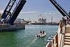 Passenger bridge raises for small boat traffic.