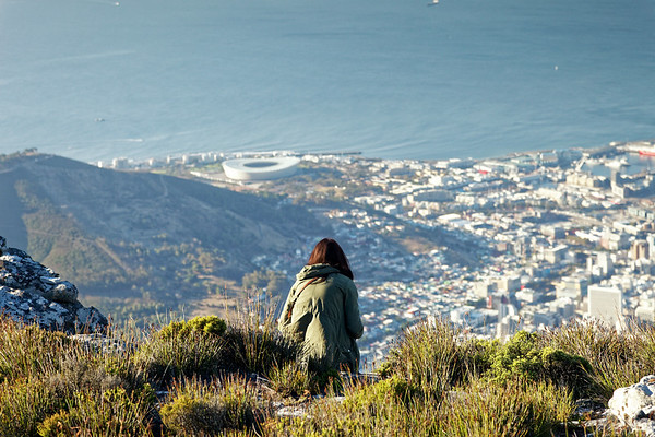 A girl looks down on Cape Town from Table Mountain