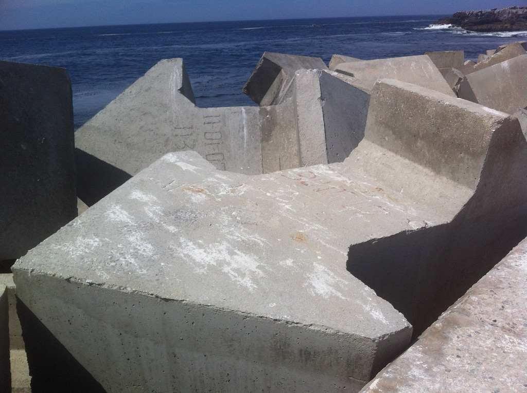 These specially shaped blocks of concrete are placed at the side of the harbour to help dissipate the impact of waves - their shape locks the blocks together under impact