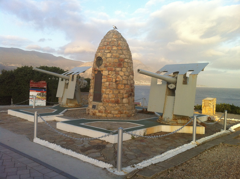 The Hermanus War Memorial as the day's light fades - note the seagull keeping watch on the top of the memorial.