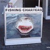 Fishing charters sign at the Waterfront in Cape Town, South Africa in February 2015. Big shark