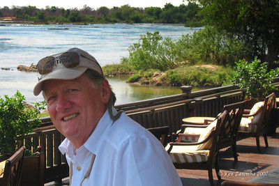 Mr. Safari Man on the Royal Livingston Hotel veranda  by the LOW Zambezi