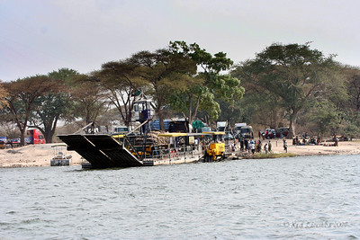 Ferry departing the Botswana side of the Zambezi river where Namibia, Zambia, Botswana and Zimbabwe connect. This is only way to cross the river where these four countries meet.