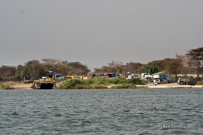 Trucks awaiting the Ferry to transport them across the Zambezi River where Zambia, Namibia, Zimbabwe and Botswana meet.