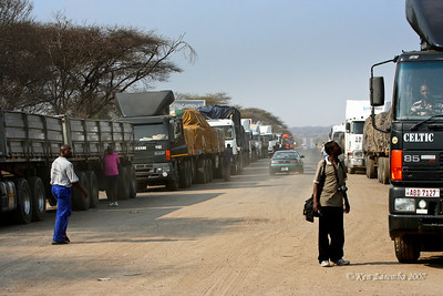 Trucks awaiting the Ferry to transport them across the Zambezi River where Zambia, Namibia, Zimbabwe and Botswana meet.