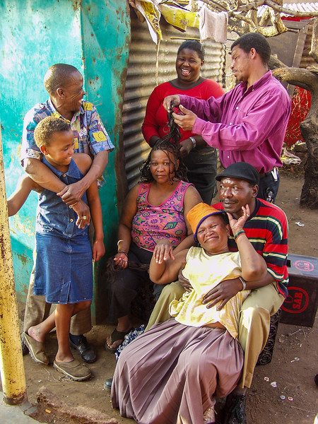 Stanley (left) and his family. Soweto, JB/SA