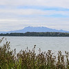 "Puerto Varas, located on the shore of Lake Llanquihue, is known as the ""City of Roses"". Osorno volcano viewed from the shore.ile"