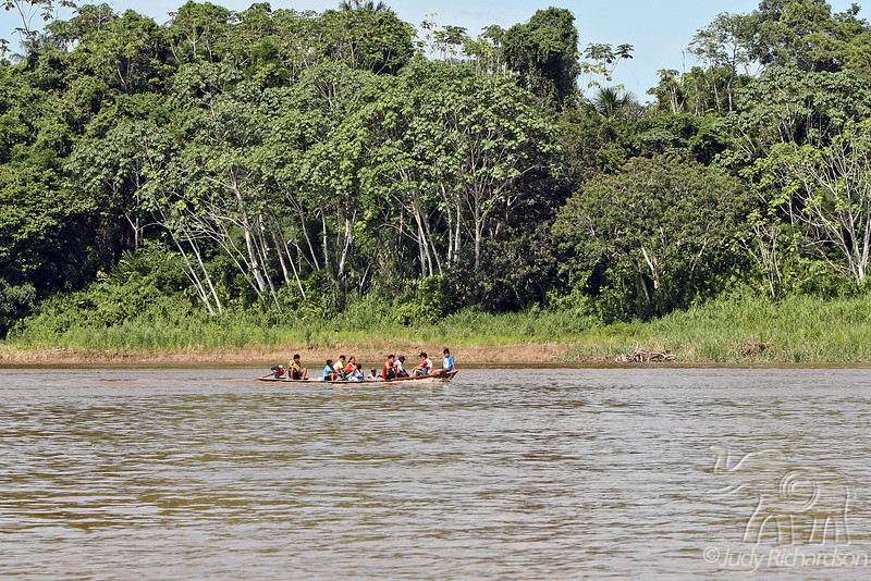 Local people traveling on the Amazon