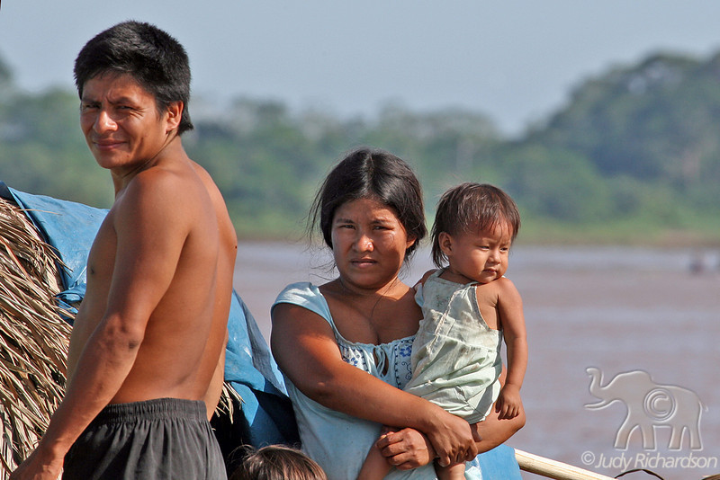 Amazon family selling goods off boat