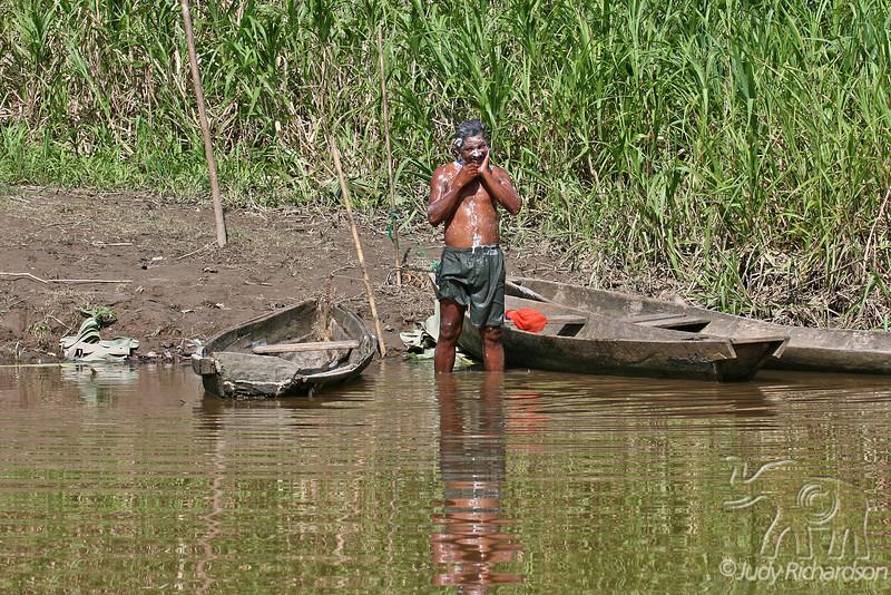 Man bathing in stream