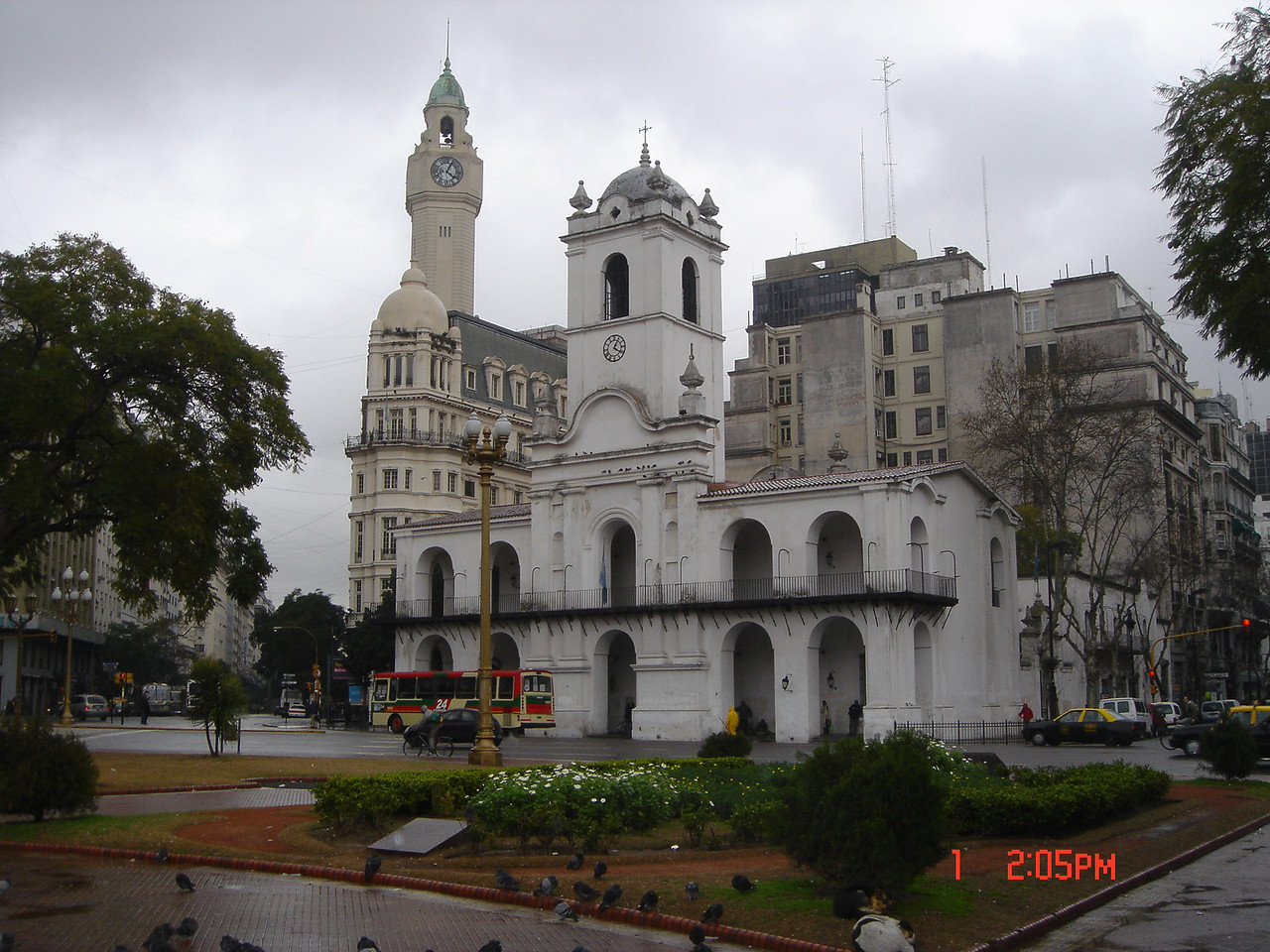 The historical white single clock tower Cabildo and the clock tower of the Legislature Building, Buenos Aires, Argentina