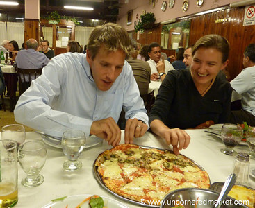 Grabbing for a Slice of Pizza - Buenos Aires, Argentina