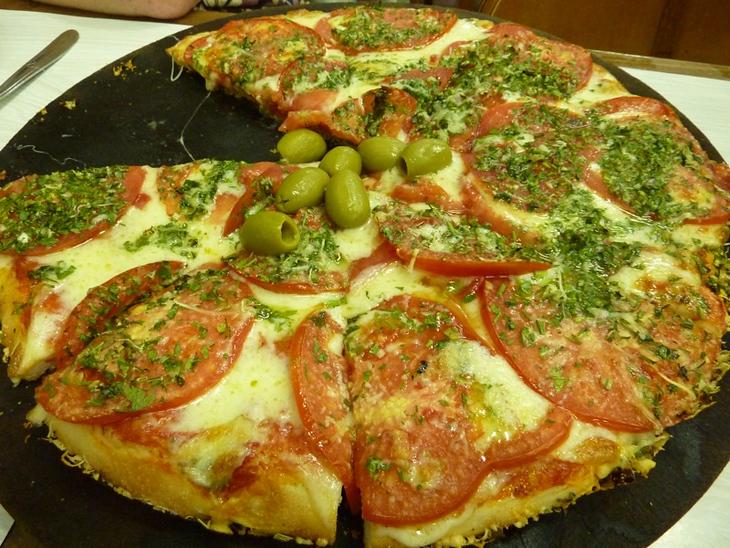 Pizza at El Cuartito - Buenos Aires, Argentina