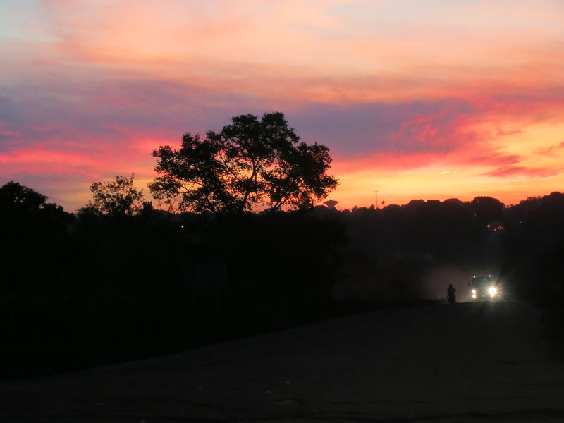 On the road back to San Ignacio, Bolivia at sunset. Motorcycle and truck heading our way.