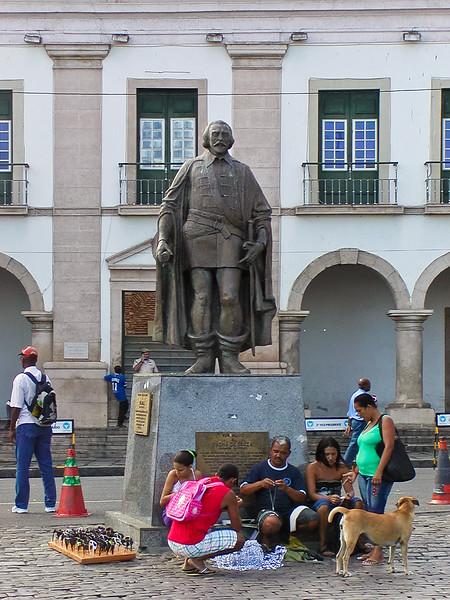 Street Vendors beneath Statue; Salvador, Brazil