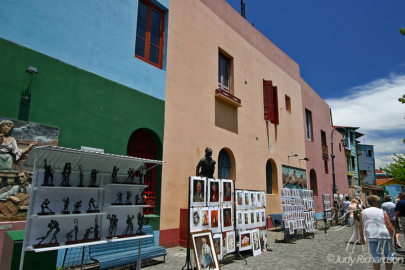 Colorful buildings on the streets of La Boca attract tourists to the neighborhood where tango was born.