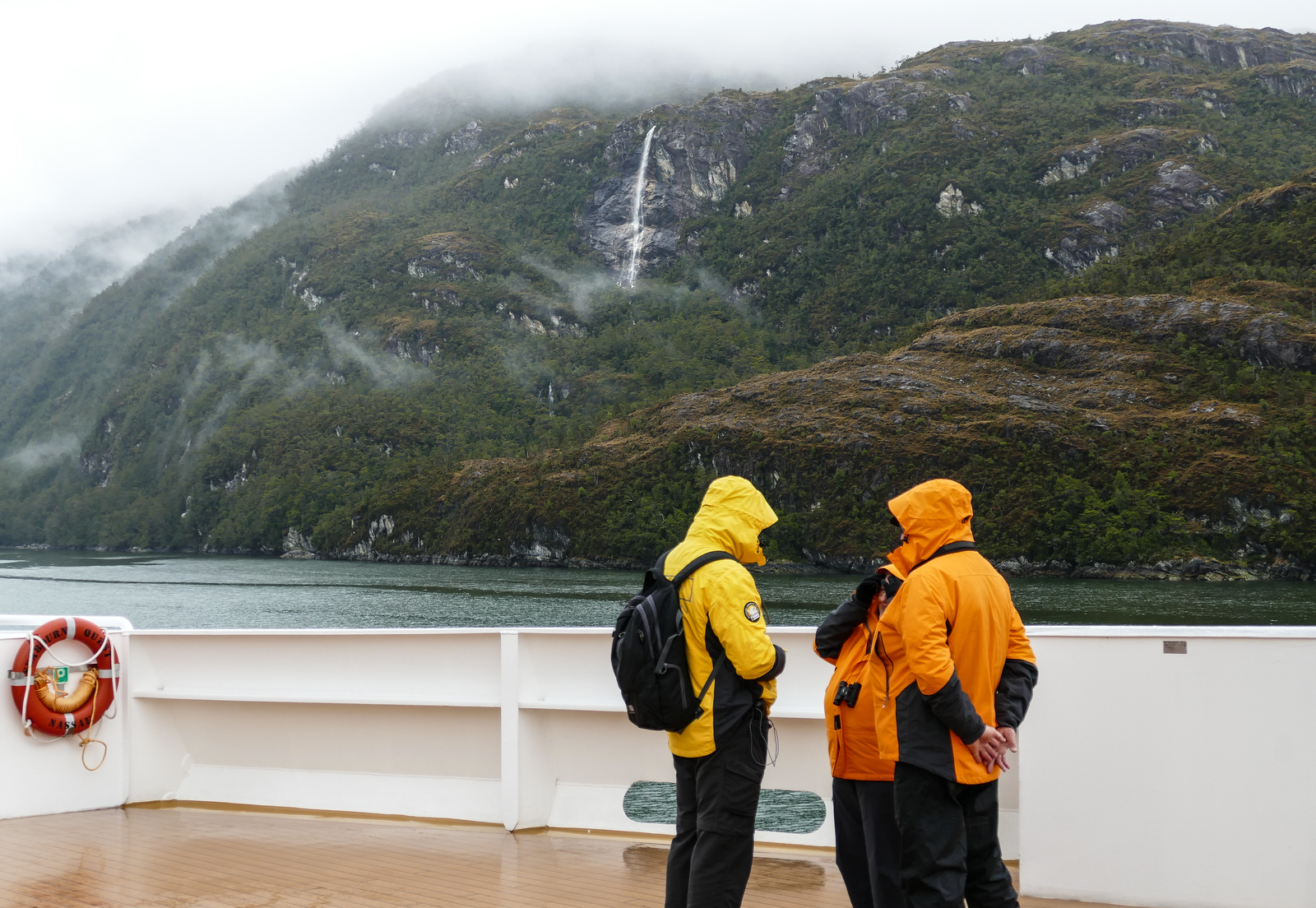Seabourn guests wait to photograph El Brujo Glacier in Chile. It's part of the travel fun on a cruise through the Chilean fjords.