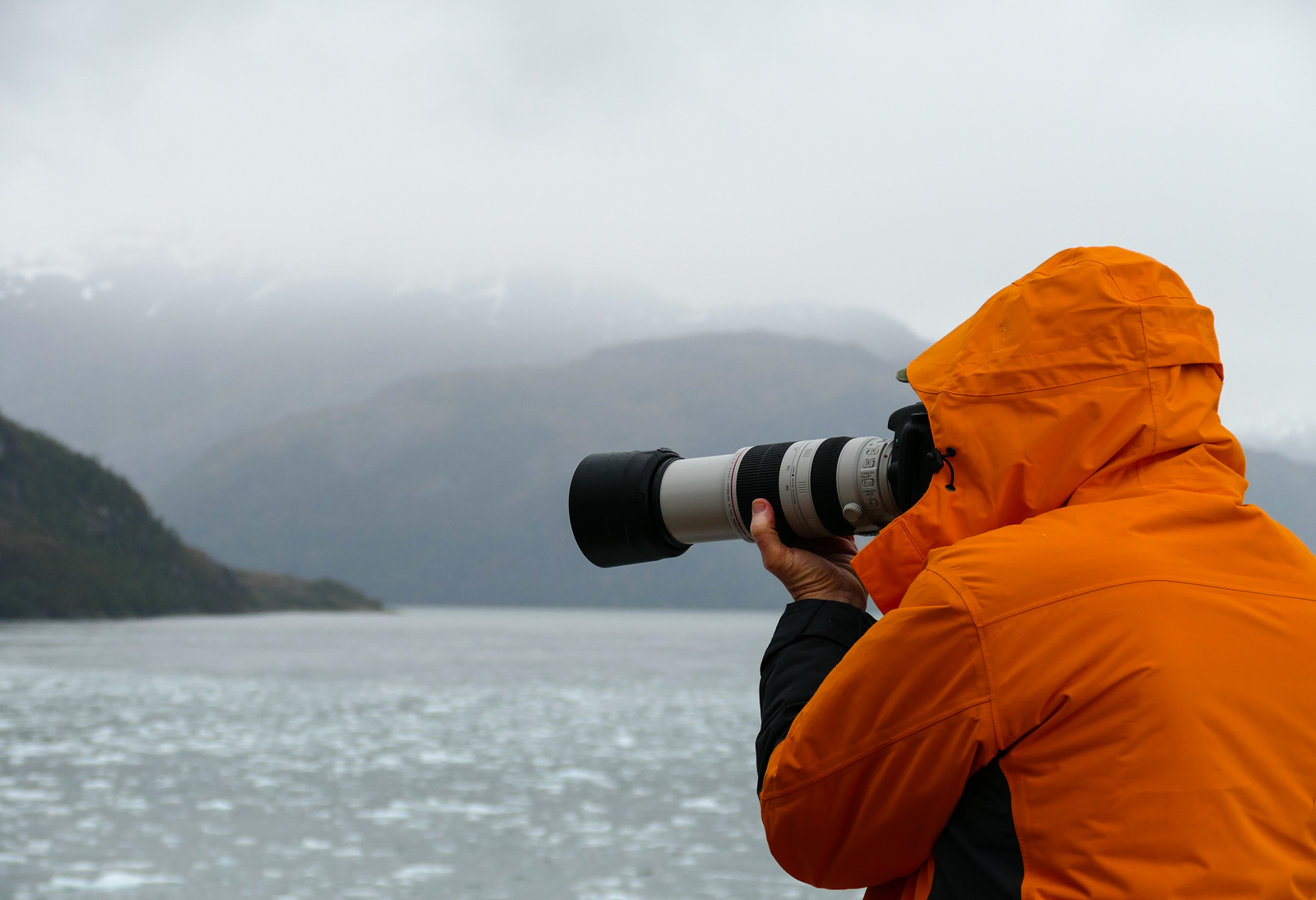 Photographing the scenery is part of the travel fun on a cruise to El Brujo Glacier.