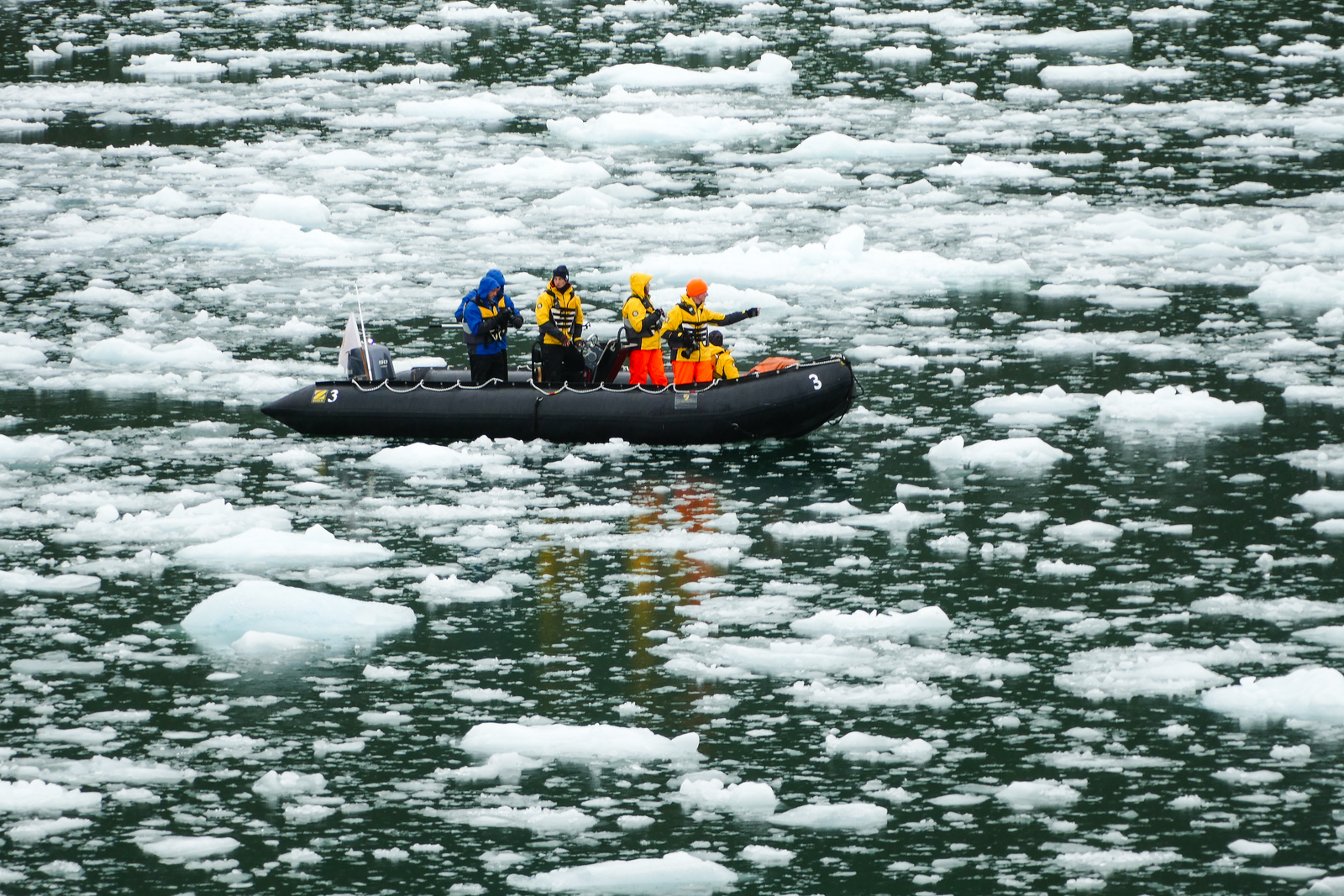 A zodiac explores the waters of Asia Fjord near El Brujo glacier in Chile. What a travel experience!