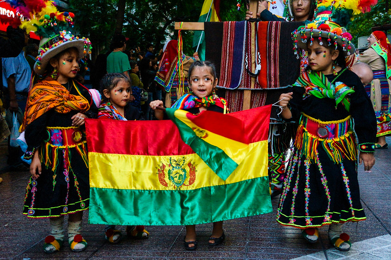 Girls carrying flag at Fiesta de la Chakana in Santiago de Chile.