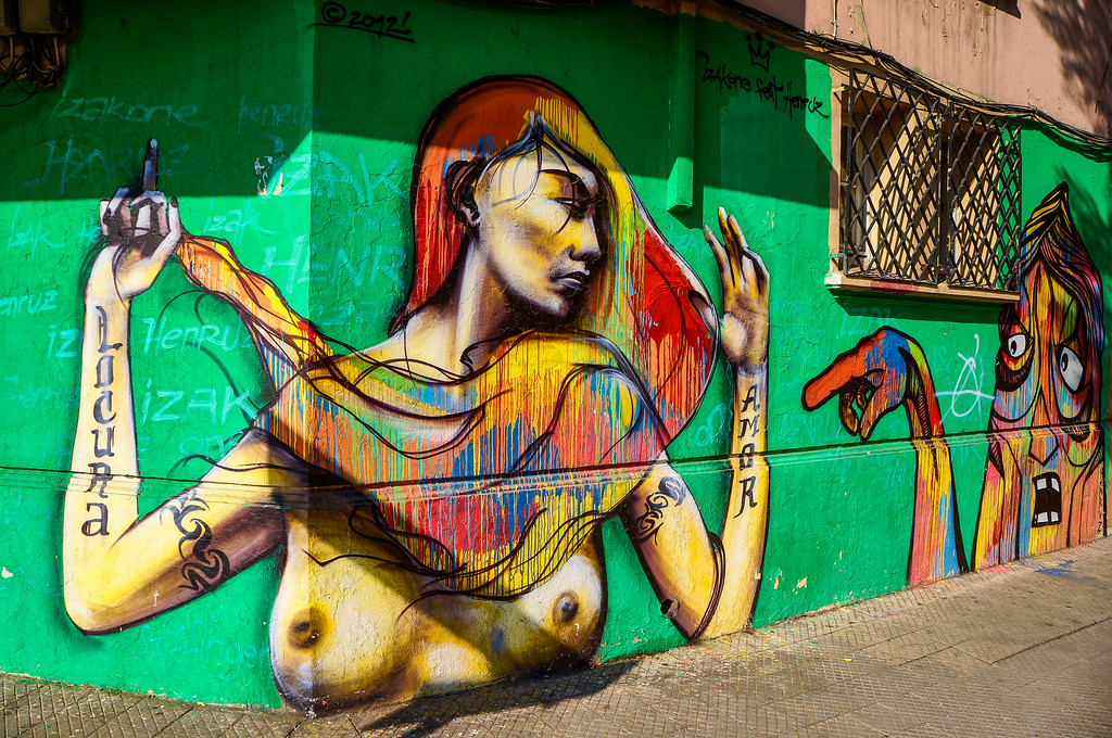 Mural by Isakone & Henruz in Santiago, Chile