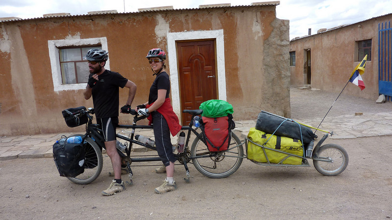 French couple crossing the desert on a tandem