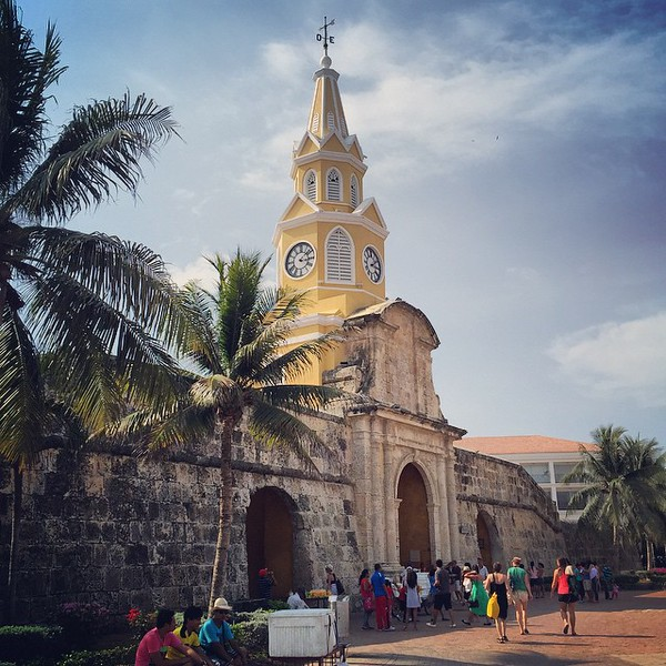 Cartegena clock tower, one of the main entrances to the old town where sailors would drop in on the local salsa club, Don de Fidel between bits of nefarious activity. The city walls date back to the 1650s and used to run 11km. 8km remain today for people to walk, grab a cerveza and catch a Caribbean breeze. via Instagram http://ift.tt/1SP9edS