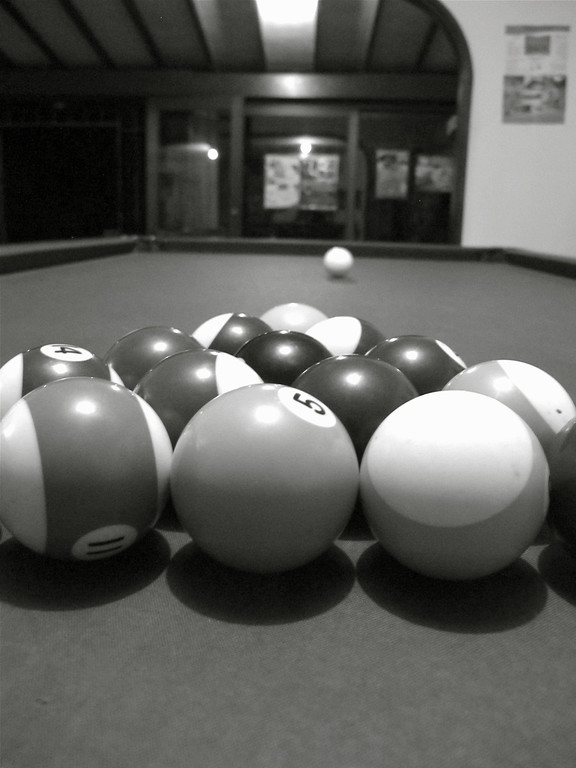 Playing billiards at Hostal Medellin in Colombia