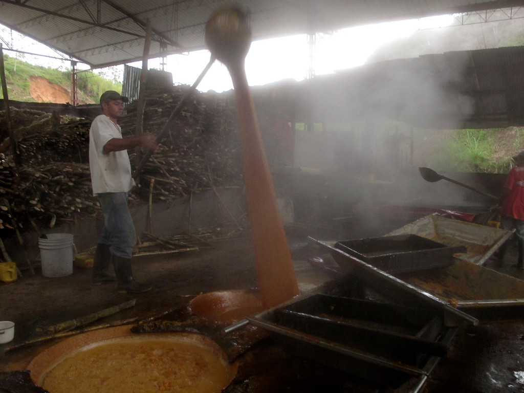 """Working the molasses at Trapiche Gualanday near Yolombó, Colombia For the full story, check out: <a href=""""http://www.nomadbiba.com/wp/2011/06/panela-the-purest-sweetness-from-the-cane/""""> Panela – The Purest Sweetness From The Cane</a>"""