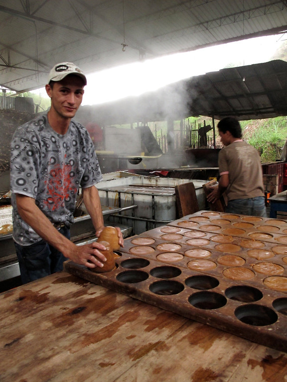 """Getting the panela in their molds For the full story, check out: <a href=""""http://www.nomadbiba.com/wp/2011/06/panela-the-purest-sweetness-from-the-cane/""""> Panela – The Purest Sweetness From The Cane</a>"""