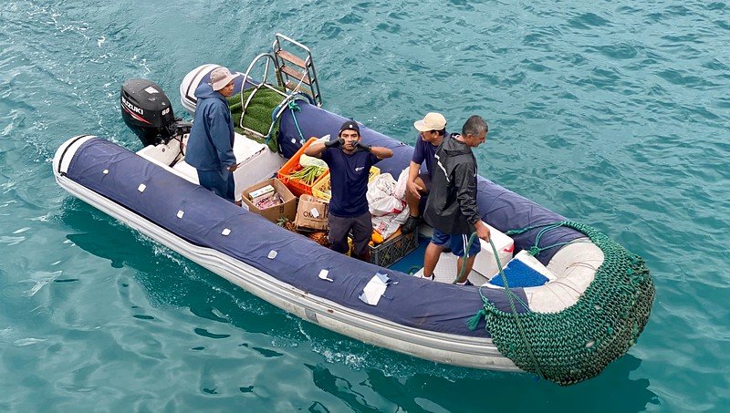 """Darwin shows """"love"""". Crew restocking provisions for the next dive group, San Cristobal Harbor."""
