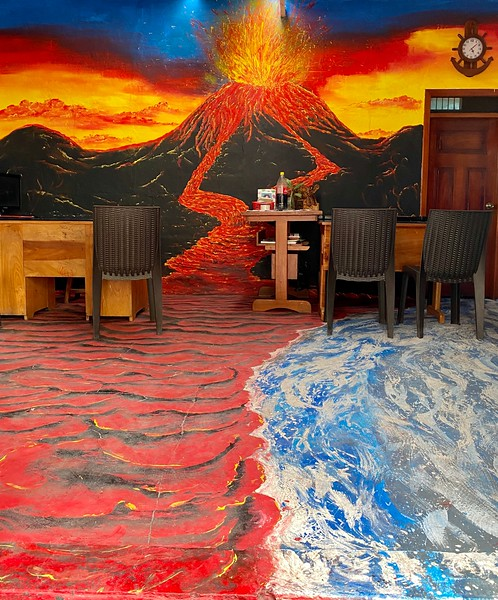 Dive shop, creatively painted with erupting volcano