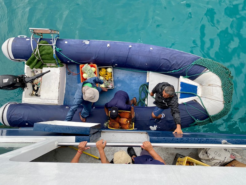 Crew restocking provisions for the next dive group, San Cristobal Harbor