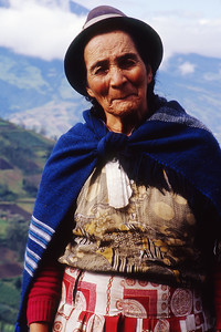 A local farm woman poses near Lieto, a short distance from the city of Banos.