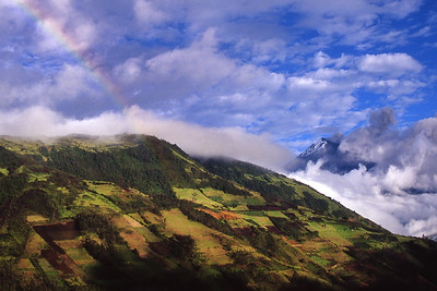 A rainbow following a rain shower, as Tungurahua volcano spews ash