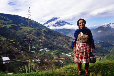 A local woman poses with Tungurahua volcano in background