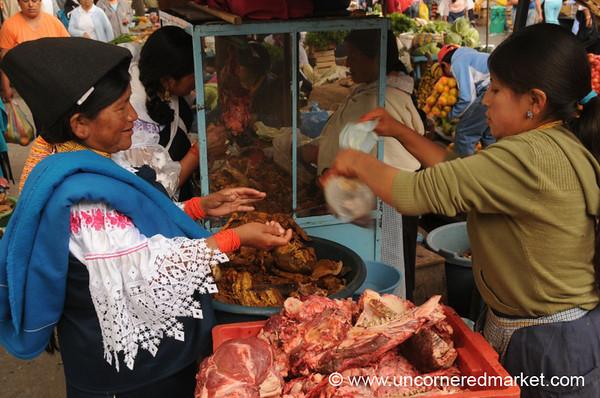 Packing Up the Meat - Otavalo Market, Ecuador