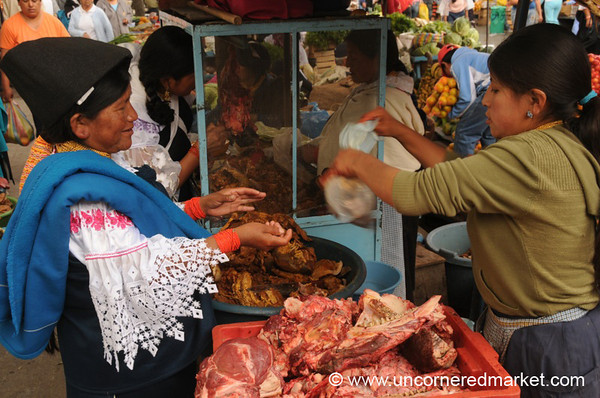 Packing Up the Meat - Otavalo Market, Ecuador